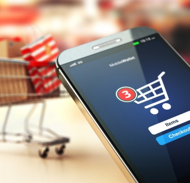 Online shopping concept. Mobile phone or smartphone with cart